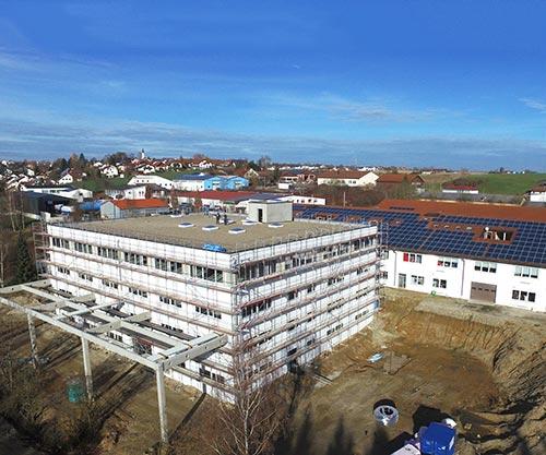 2017 Luftaufnahme Bau Gebäude 3 nah - Geschichte des Unternehmens